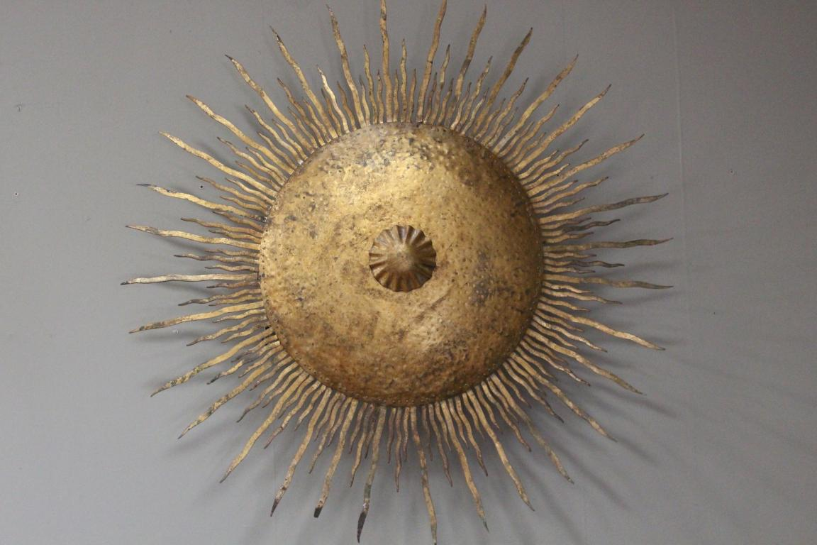 A large scale sunburst applique in lighting